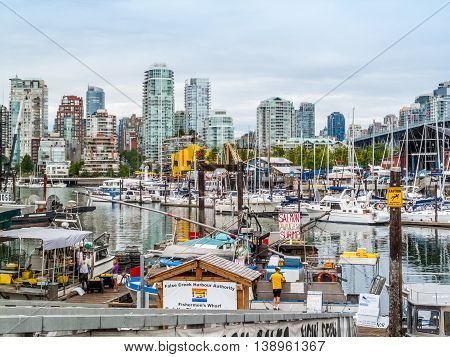 Vancouver British Columbia Canada - June 27 2009 : False Creek Harbour and view of downtown Vancouver's Yaletown skyline Vancouver British Columbia Canada