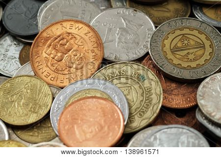 Assorted foreign coins close up in macro