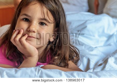 indoor portrait of young smiling child girl at home, room interior background