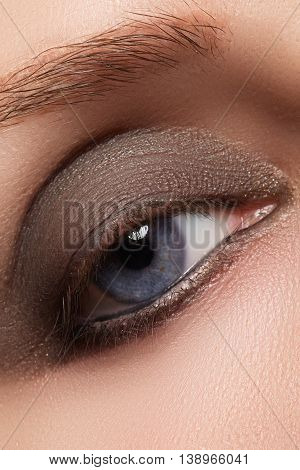 Close-up Of Woman Eye With Beautiful Brown Smokey Eyes Make-up