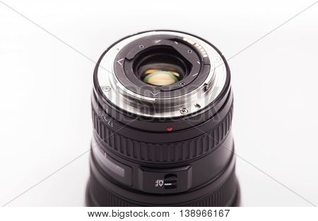 The rear portion of a wide angle lens on white background
