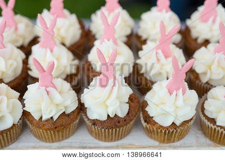 Pink Bunny Cupcakes With White Icing In A Row