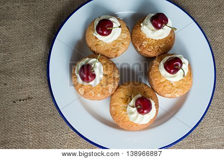 Cherry And Almond Cupcake On A Plate Shot Overhead
