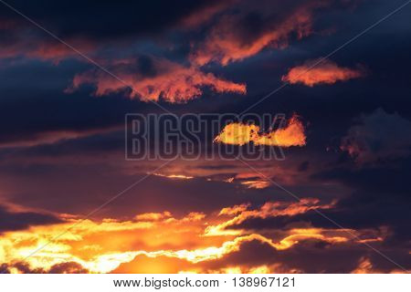 a vibrant orange and golden sunset sky