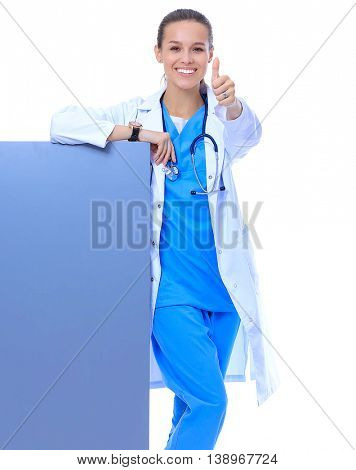 Portrait of young female doctor showing blank signboard, with okay gesture
