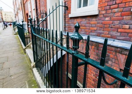 Traditional Fence In Front Of City Houses In London