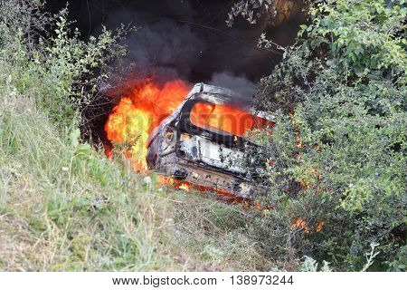 TULCEA, ROMANIA - JUNE 11: Danube Delta Rally special trial windfarm on June 11, 2016 in Tulcea, Romania; car on fire