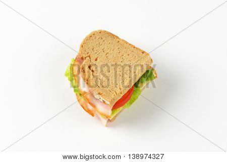 sandwich made from continental bread, ham, cheese, lettuce and tomato