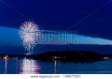 steamboat bay in east gull lake during fourth of july fireworks celebration over lake outside brainerd minnesota