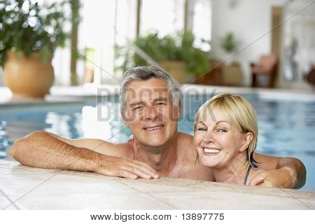 Middle Aged Couple In Swimming Pool