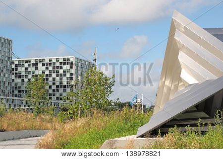 The Hague Netherlands - July 5 2016: The International Criminal Court forecourt sculpture and entrance at the new 2016 opened ICC building.