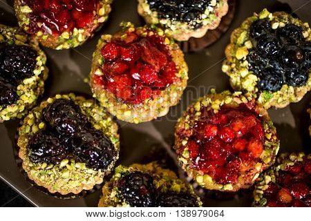 Dessert Fruit tartlets with strawberries and blueberries
