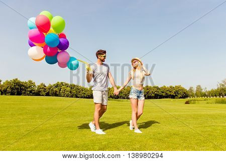 Two Happy Young Lovers Having Date In The Park