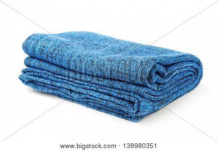 Folded blue warm blanket isolated on white