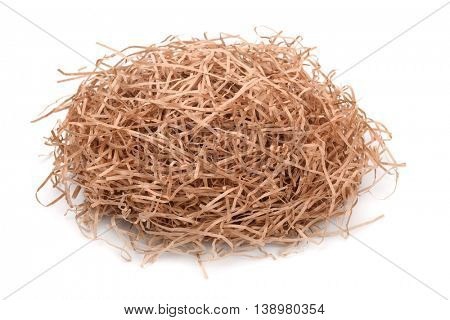 Shredded kraft paper filler isolated on white