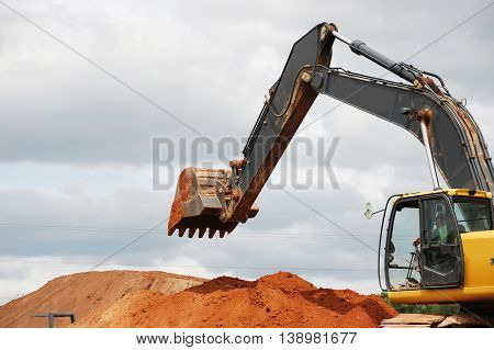 operating excavator in construction site for design