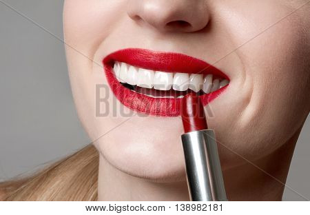 Professional Make up. Lipstick. Bright make up with perfect clean skin with colorful red lips and lipstick