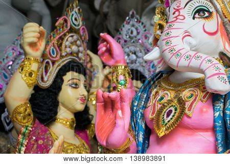 KOLKATA WEST BENGAL INDIA - 13 SEPTEMBER 2015: Colorful painted clay idol of Lord Ganesha and Kartik as preparation for