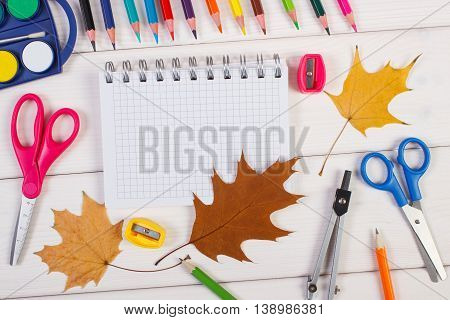 School Accessories And Orange Leaves On White Boards, Back To School Concept