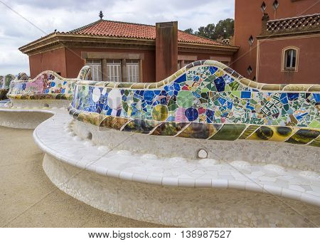 BARCELONA SPAIN - JULY 3 2016: Colorful ceramic bench in Park Guell. Park Guell (1914) is the famous architectural town art designed by Antoni Gaudi.