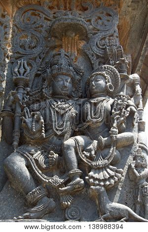 Parvati Sitting On The Lap Of Lord Shiva; Carved In Hoysaleshwara Temple At Halebidu