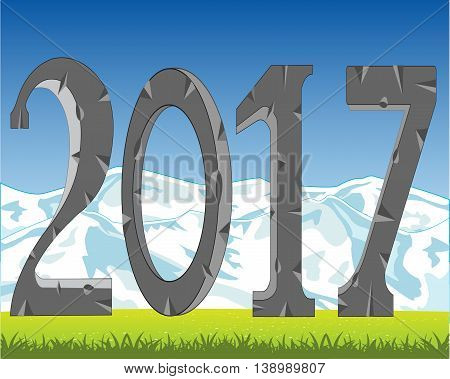 Stone numerals year 2017 on background of the nature