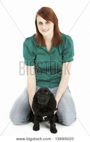 Girl With Black Spaniel Puppy