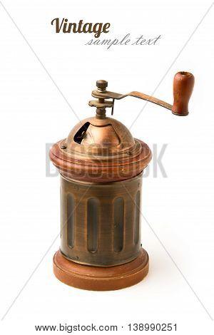 Vintage metal coffee grinder on white background