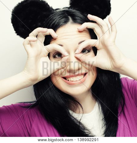 Surprised funny young woman with mouse ears