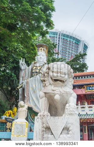 REPULSE BAY HONG KONG - MAY 23: The celestial lion statue and Kwun Yam statue at Kwun Yam temple on May 23 2016 in Repulse Bay Hong Kong.