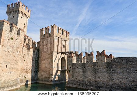 The Scaliger Castle is a medieval port fortification located at the entrance to the sirmio peninsula which divides the lower part of Lake Garda.