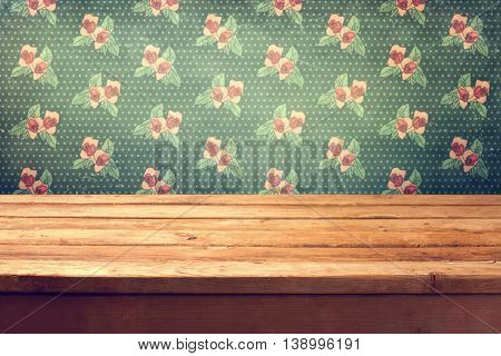 Background with empty wooden ceck table and shabby chic wallpaper