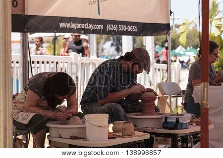 Costa Mesa, California - July 16, 2016: Potters shape clay on a wheel at the display for Muddys Studio at the Orange County Fair.