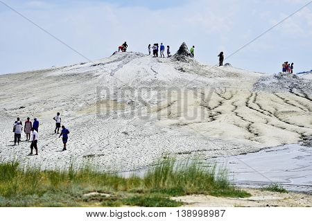 BERCA ROMANIA - JULY 2: Tourists visiting the mud active volcanoes in Berca on June 2 2016 in Romania
