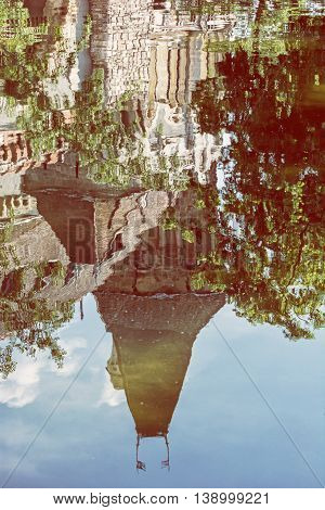 Beautiful Vajdahunyad castle is reflected in the water of the lake Budapest Hungary. Cultural heritage. Travel destination. Vertical composition. Famous place. Retro photo filter. Architectural theme.