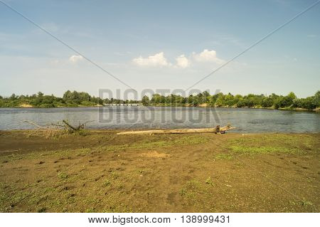 Beautiful river landscape by summer with green tree ashore