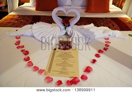 Bedroom in Hotel Suite with Heart Shaped Decorations. Interior Of Bedroom Of Luxury Hotel Suite.