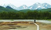 stock photo of steam sterilization  - Man walking of the hydrotermal park  on Kamchatka - JPG