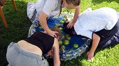 picture of childrenwear  - girls playing apple bobbing - JPG