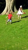 pic of childrenwear  - Children/boy and girl running/playing. Happy/healthy children playing. motion. movement.