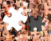 picture of brain teaser  - Group of business people in pieces of a puzzle - JPG