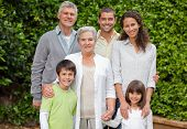 picture of extended family  - Portrait of a happy family looking at the camera in the garden - JPG