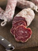stock photo of charcuterie  - Selection of French Sausages on a cutting board - JPG