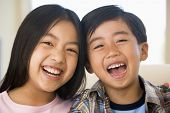 stock photo of brother sister  - Brother And Sister Laughing - JPG