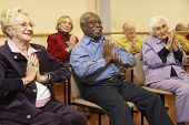 picture of senior adult  - Senior adults in a stretching class - JPG