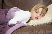 picture of young girls  - Young Girl Unwell Lying On Sofa - JPG