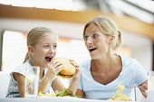 image of mother daughter  - Mother And Daughter Having Lunch Together At The Mall - JPG