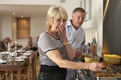stock photo of senior adult  - Couple Having Difficulty Cooking For A Dinner Party - JPG