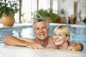 stock photo of portrait middle-aged man  - Middle Aged Couple In Swimming Pool - JPG