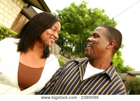 African American Couple With House Background 2